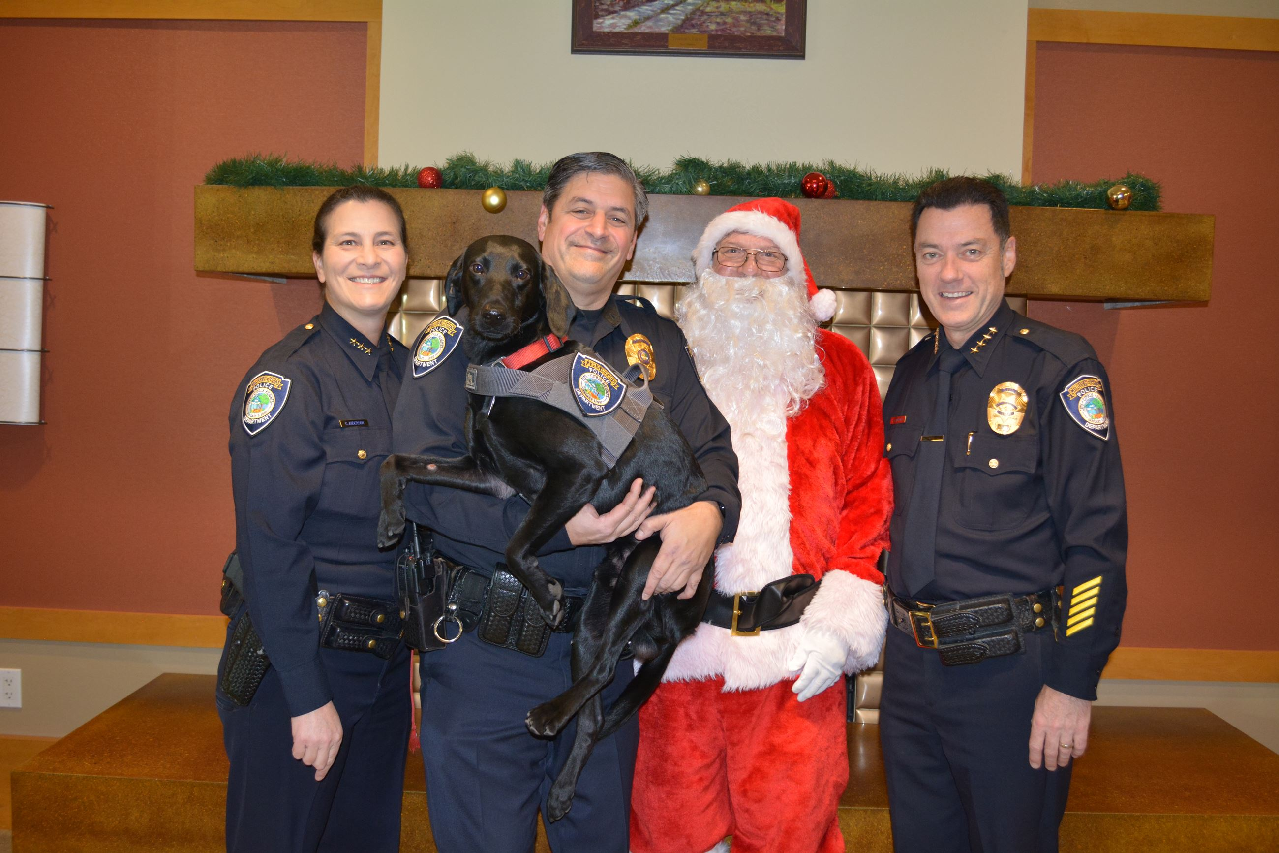 Assistant Chief Anderson, Detective Moranz, K9 Farley, Santa, Chief Lawrence