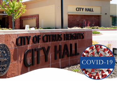 Image of the front of City Hall with a COVID-19 icon