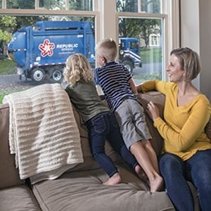 Family Watching Republic Garbage Truck