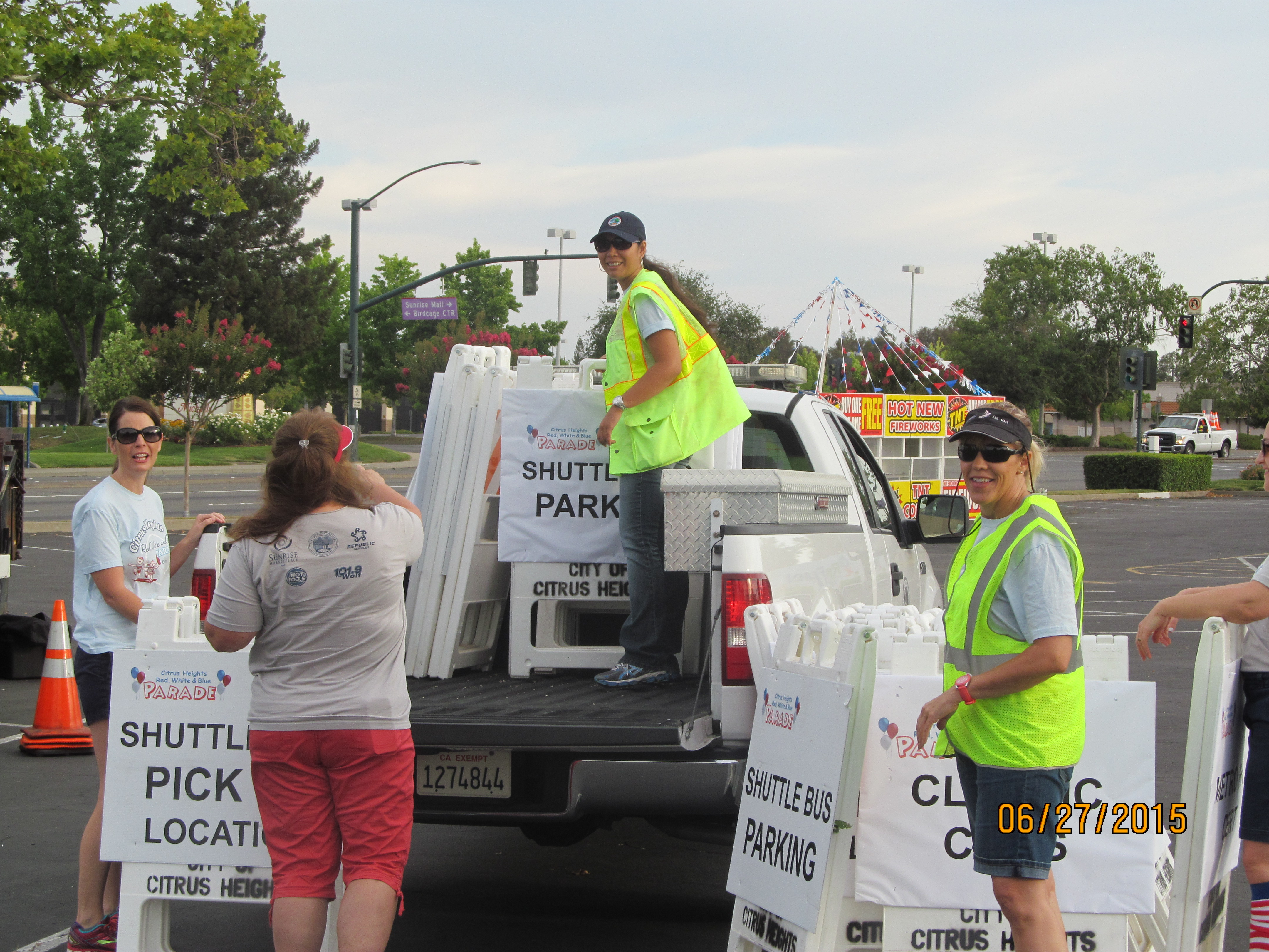 Volunteers setting parade signage